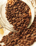 Heap of coffee beans from jar Stock Image