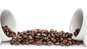 Heap of coffee beans with two cups Stock Image