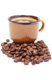 Heap of coffee grains and cup of beverage Royalty Free Stock Photos