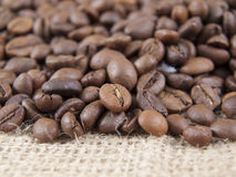 Coffee grains and sack Stock Photos