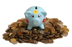 Heap of coins. Pig money box on heap of coins Royalty Free Stock Photography