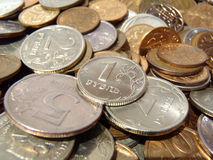 Heap of coins closeup Stock Photos