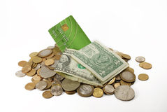 Heap of coins and credit card. Heap of coins with dollars and credit card Royalty Free Stock Photo