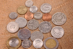Heap of coins of different countries Stock Image