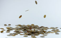 Heap of coins falling to the ground Royalty Free Stock Images