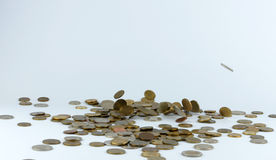 Heap of coins falling to the ground Stock Photo