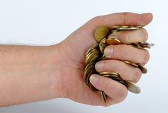 Heap of coins in the hand Royalty Free Stock Image