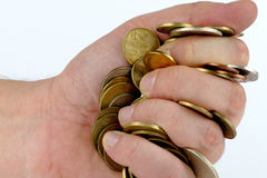 Heap of coins in the hand Stock Photo
