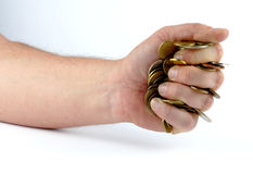 Heap of coins in the hand Royalty Free Stock Images