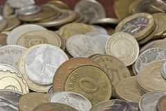Heap of coins loose stock photography