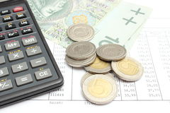 Heap of coins, paper money and calculator on spreadsheet Royalty Free Stock Photo