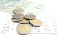 Heap of coins and paper money lying on spreadsheet Stock Images