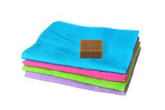 Heap of color towels with soap Royalty Free Stock Photos