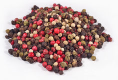 Heap of colored pepper on a white Stock Photography