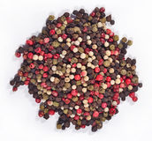 Heap of colored pepper on a white Royalty Free Stock Image