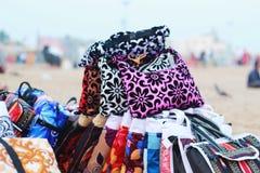 Heap of colorful bag at sea beach stock photo