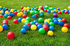 Heap of Colorful Balls on green grass Stock Photos