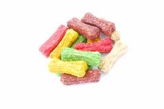 Dog treats. Heap of colorful bone shaped dog food. Image isolated on white studio background Stock Photography