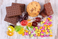 Heap of colorful candies and cookies, too many sweets Royalty Free Stock Photo