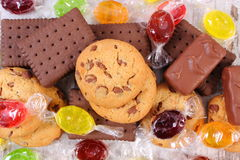 Heap of colorful candies and cookies, too many sweets Stock Photos