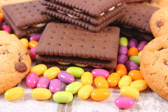 Heap of colorful candies and cookies, too many sweets Royalty Free Stock Photos
