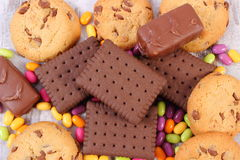 Heap of colorful candies and cookies, too many sweets Stock Image