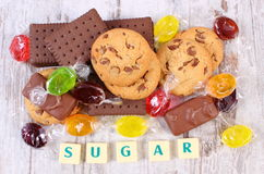 Heap of colorful candies and cookies, too many sweets Royalty Free Stock Images