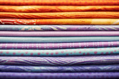 Heap of colorful fabric Stock Photos