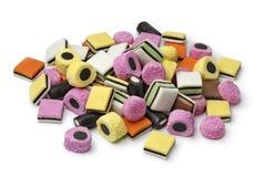 Heap of Liquorice allsorts. Heap of colorful Liquorice allsorts  isolated on white background Royalty Free Stock Image