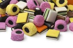 Heap of Liquorice allsorts. Heap of colorful Liquorice allsorts on white background Stock Photo