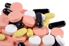 Heap of colorful pills on a white Stock Photography