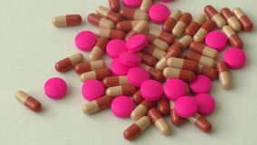 Heap of colorful pills on a white background stock footage