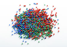 Heap of colorful plastic granules. Or pellets made from recycled waste for use in the industry to manufacture new products on a white background royalty free stock images