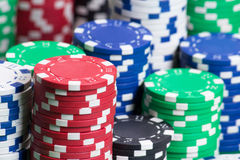 Heap of colorful poker chips in casino Royalty Free Stock Image