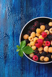 Heap of colorful raspberries Stock Image