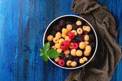 Heap of colorful raspberries Stock Images
