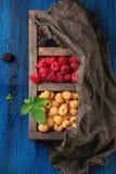 Heap of colorful raspberries Stock Photo