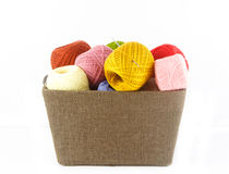 Heap of colorful yarn in basket on white background Royalty Free Stock Photos