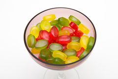 Heap colors candy in glass bowl. On white Royalty Free Stock Image