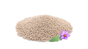 Heap of composite mineral fertilizers. With leaf and  flower, isolated on the white background Stock Images