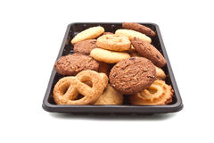 Heap of cookie on black plastic tray,  on white Stock Image