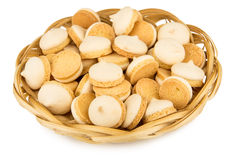 Heap of cookies with egg glaze in wicker basket Stock Photography