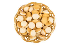 Heap of cookies with egg glaze in wicker basket Royalty Free Stock Image