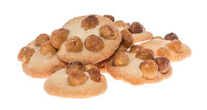 Heap of Cookies topped with Hazelnuts Royalty Free Stock Photos