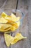 Heap of corn chips in the glass bowl on the wooden background Royalty Free Stock Photography
