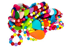 Heap of costume jewellery. Heap of multi-coloured costume jewellery on a white background it is isolated Stock Photography