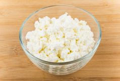 Heap of cottage cheese in transparent glass bowl Royalty Free Stock Photography