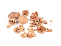 Heap of cracked walnuts. Stock Images