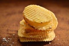 Heap of crisps. A little heap of salty crisps Stock Images