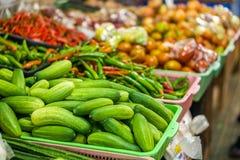 Heap of cucumbers (Cucumis sativus) in plastic basket Stock Photo